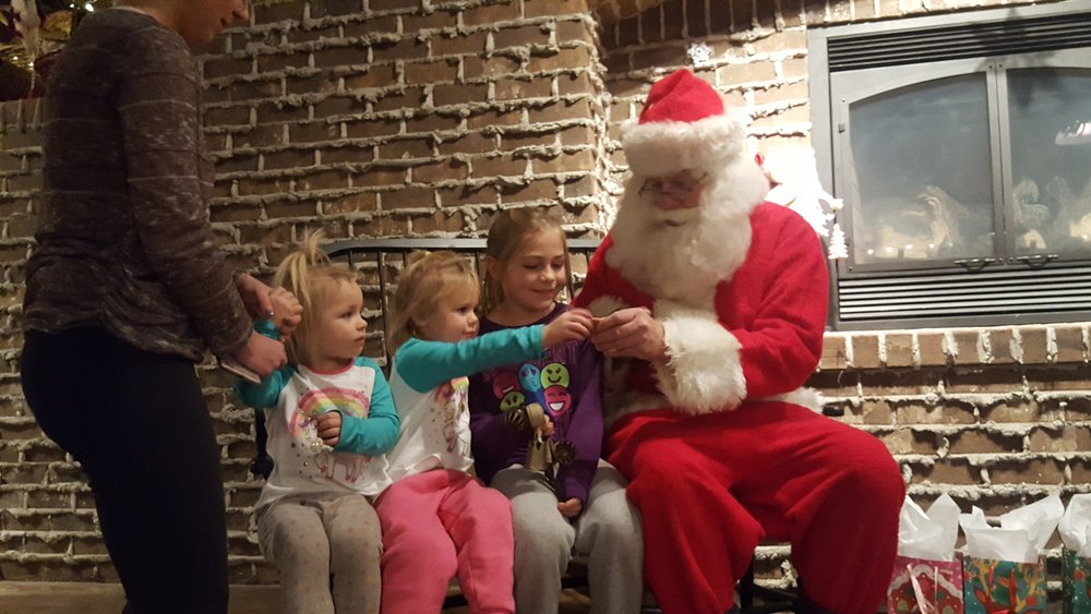 Sisters share a moment with Santa -