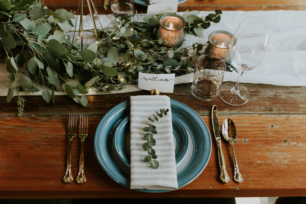Amidst the scape of golds, florals, and shimmer, we needed an element of masculinity to help balance the vision. I opted for a neutral stripe to add a more modern vibe. The beautiful rustic table was a perfect foundation to build on.
