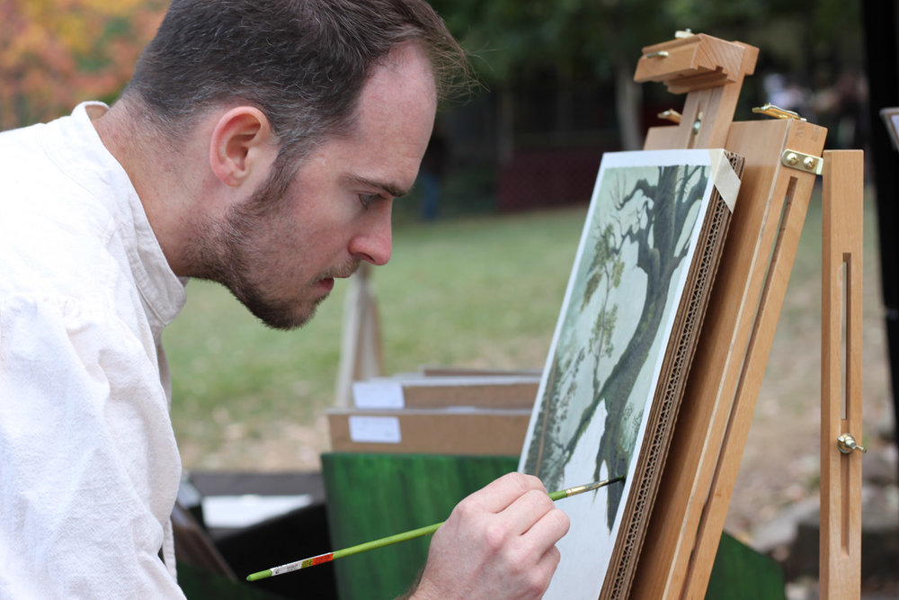 jon-carraher-fantasy-artist-working-at-his-easel-at-outdoor-festival-IMG_1935.jpg