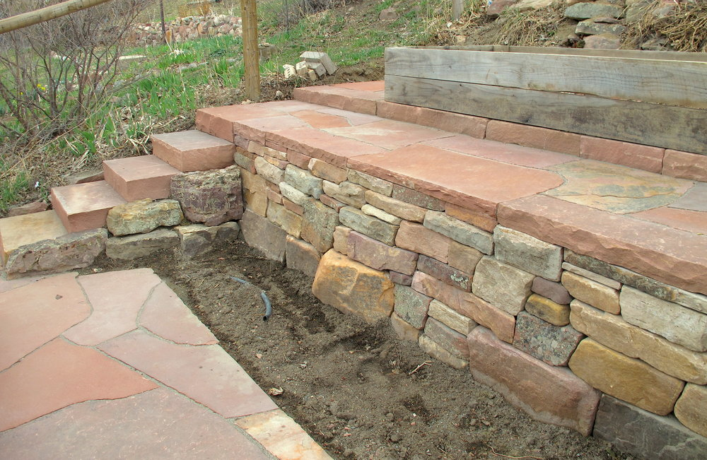 dry stack stone wall | landscape retaining wall