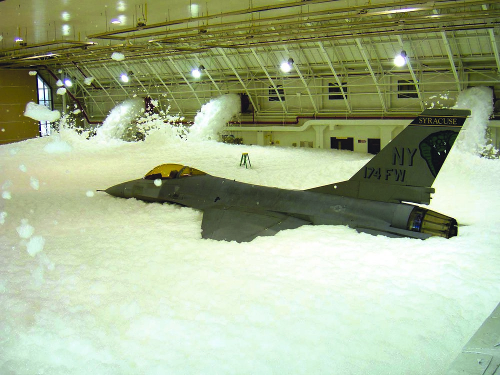 "Firefighting foam is designed to separate the fire from its oxygen supply. While the military periodically tests hangar ""deluge"" foam suppression systems, accidental releases from these systems have also occurred, resulting in potential AFFF release into the environment. Source: New York Air National Guard."
