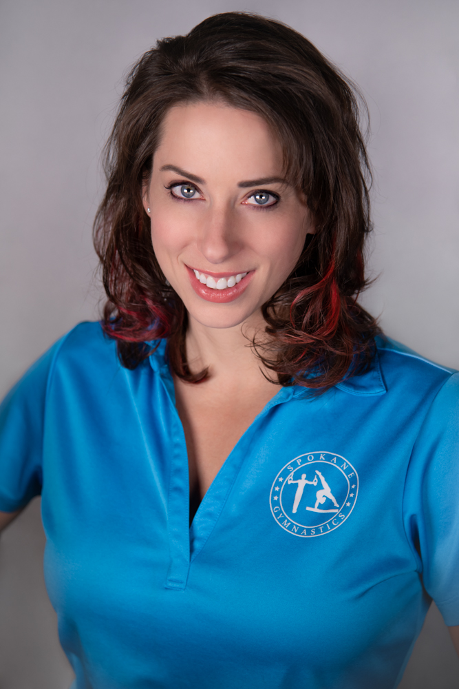 """Nadine Burgess     Owner of Spokane Gymnastics    Nadine has lived in Spokane since 2006 and now considers it her forever home. She loves the people, opportunity, outdoors and community of the Intermountain Northwest.  She enjoys fitness events, cooking, travel, field trips, """"behind the scene"""" tours, silly costumes, critters large and small, and positively impacting the lives of children.  Nadine started coaching gymnastics at 14 years old, and it remained her passion as a """"fun, side gig"""" prior to becoming a manager, then owner of Spokane Gymnastics in 2010.  A proud Rotarian, Nadine also serves as a board member of Children FIRST and Greater Spokane Incorporated.  Nadine is most famous for her """"Handstands around the World!"""""""