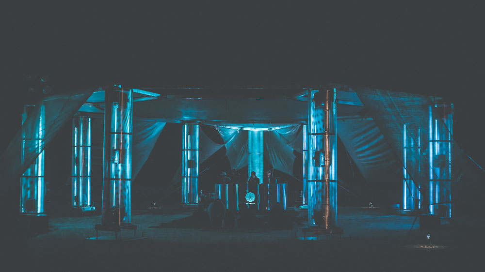 Envelop Satellite - a completely mobile sound space comprised of an 8-column, 24.4 channel Ambisonic sound system with interactive LED lights