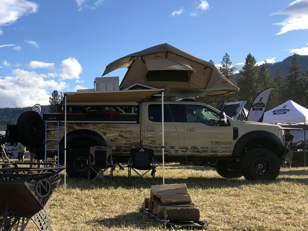 A toy hauler that attaches to our modular truck bed that gives you an upper deck over the cab for ATVs, roof top tents or additional storage.