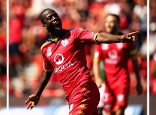 Interview by Alison Wilson. Photo: Bruce Djite of Adelaide United celebrates after scoring a goal during the round 16 A-League match between Adelaide United and Newcastle Jets at Coopers Stadium on 24 January 2015 in Adelaide. Photo by Daniel Kalisz/Getty Images.