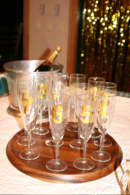 I copied this idea from an old issue of Martha Stewart Magazine—you take silver or gold number stickers and individually number your champagne glasses, like a New Year's countdown. It not only looks cute, but helps you keep track of your glass all night (very helpful on New Years!)!! Now if only I could locate numbers 3 and 6… they've gone missing since that night….