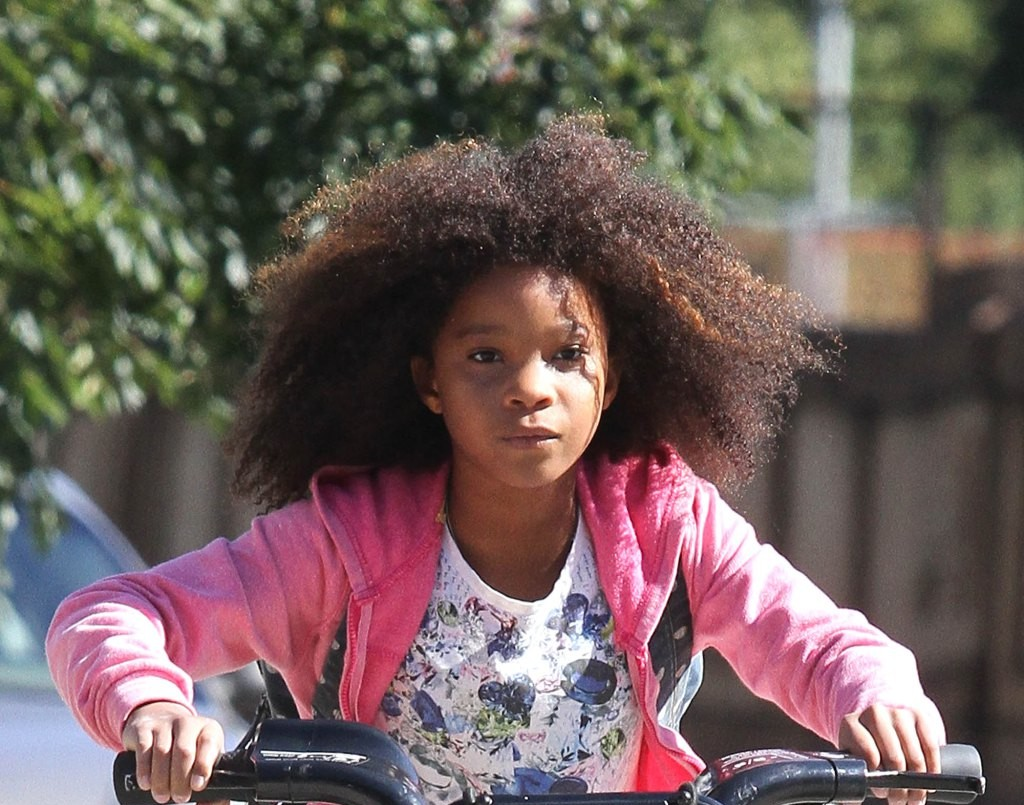 Quvenzhané Wallis rides a public bike while shooting the remake of 'Annie', on location in Harlem, NY.