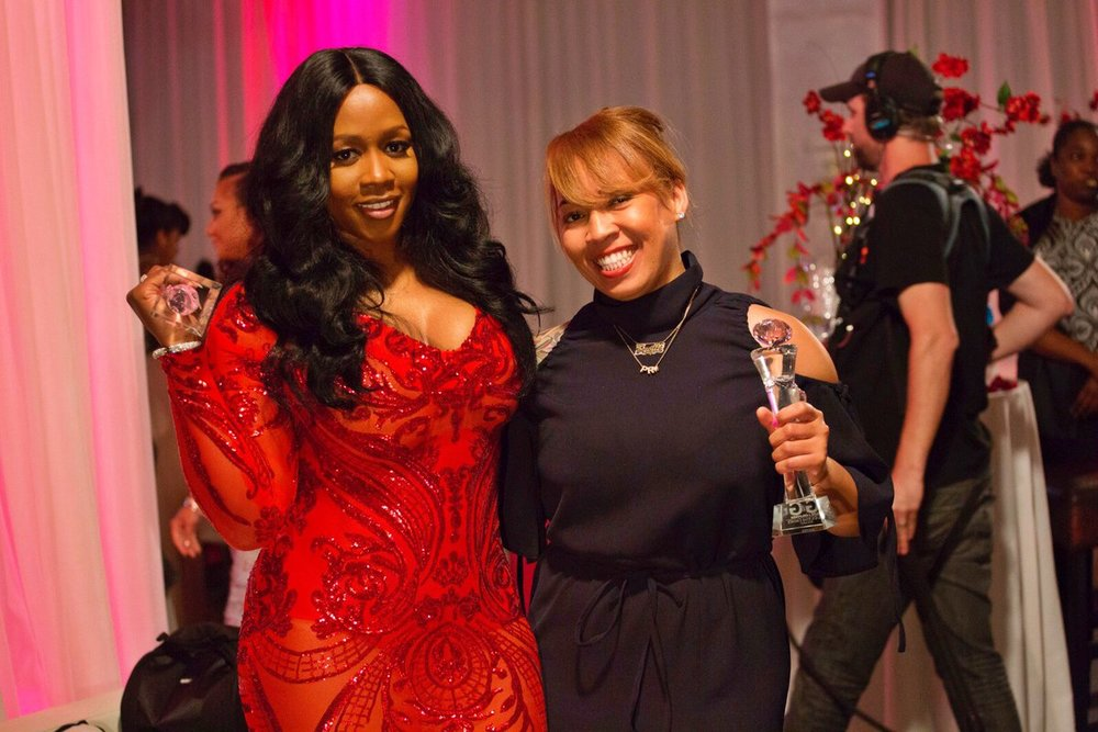 Krystle Coleman, CEO Midori Star Media Group being recognized alongside Remy Ma
