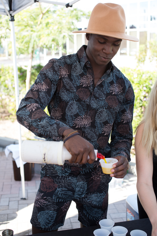 Titus Fauntleroy of St. Francis pours drinks for guests on the patio. Photo: Bite Magazine / Mark Lipczynski