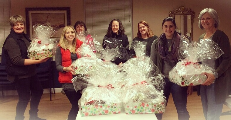 Volunteers with Holiday goodies for our  law enforcement agencies and service providers