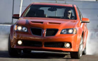 2008 Pontiac G8 GT  - Maximum Bob made one more trans-pacific shopping trip. Did he already know the jig was up?  Did he want to give Poncho fans one last fond memory? IF SO, Nice to know that not everyone in the c-suit was a bastard.  ( www.Motortrend.com )