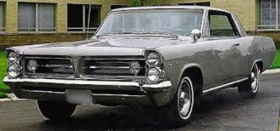 """WITH THE  1963 GRAND PRIX , PONTIAC OFFERED AN ELEGANT RESPONSE TO THE FORD THUNDERBIRD. ITS 8-BOLT ALLOY WHEELS, FINNED ALUMINUM BRAKES, BUCKET SEATS, FULL INSTRUMENTATION, ALONG WITH A REFRESHING LACK OF BODY ORNAMENTATION, CAUSED ONE COMMENTATOR TO DESRIBE THE GP'S LOOKS AS """"AN ATHLETE IN A TUXEDO."""" ( www.FiftiesWeb.com )"""