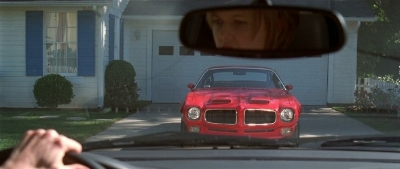 a mid-life crisis erupts in Sam Mendes'  American Beauty  (1999) wHere A big red Trans am is an automotive middle finger to the world.