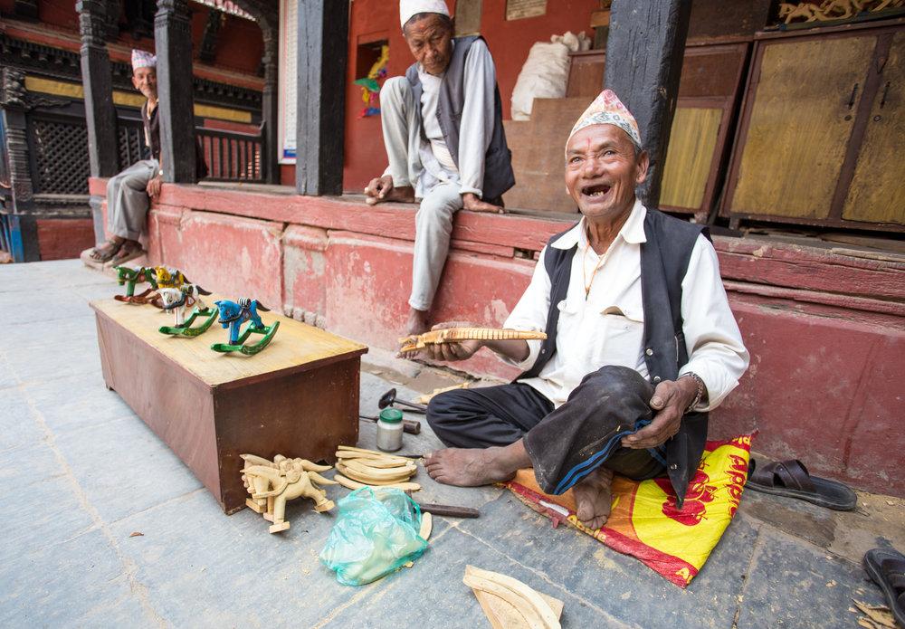 Artisan selling handmade wooden toys