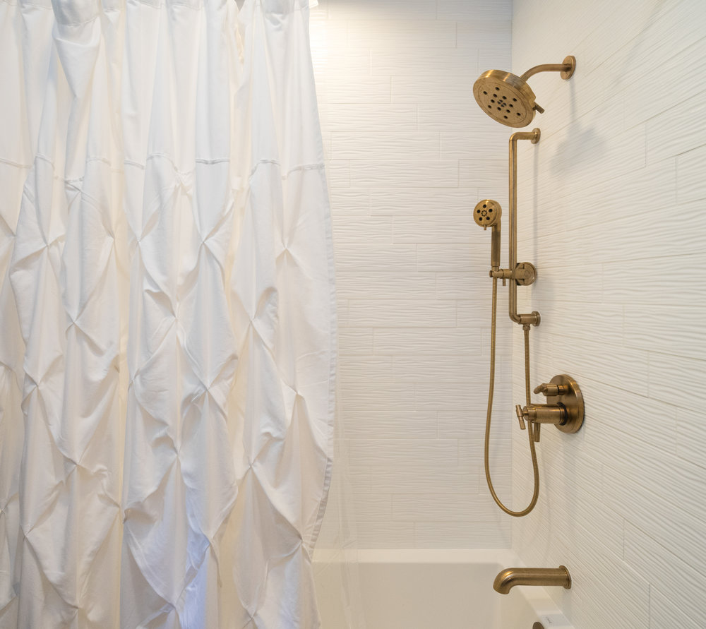 The tile in the shower was kept to a subtle white subway, while adding another texture to the space.