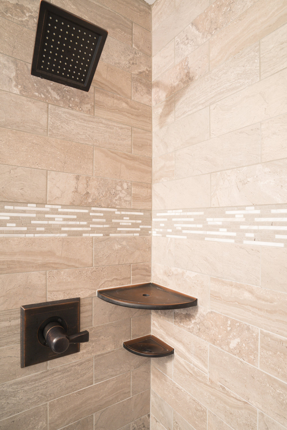 - Subway style tile with mosaic inlay