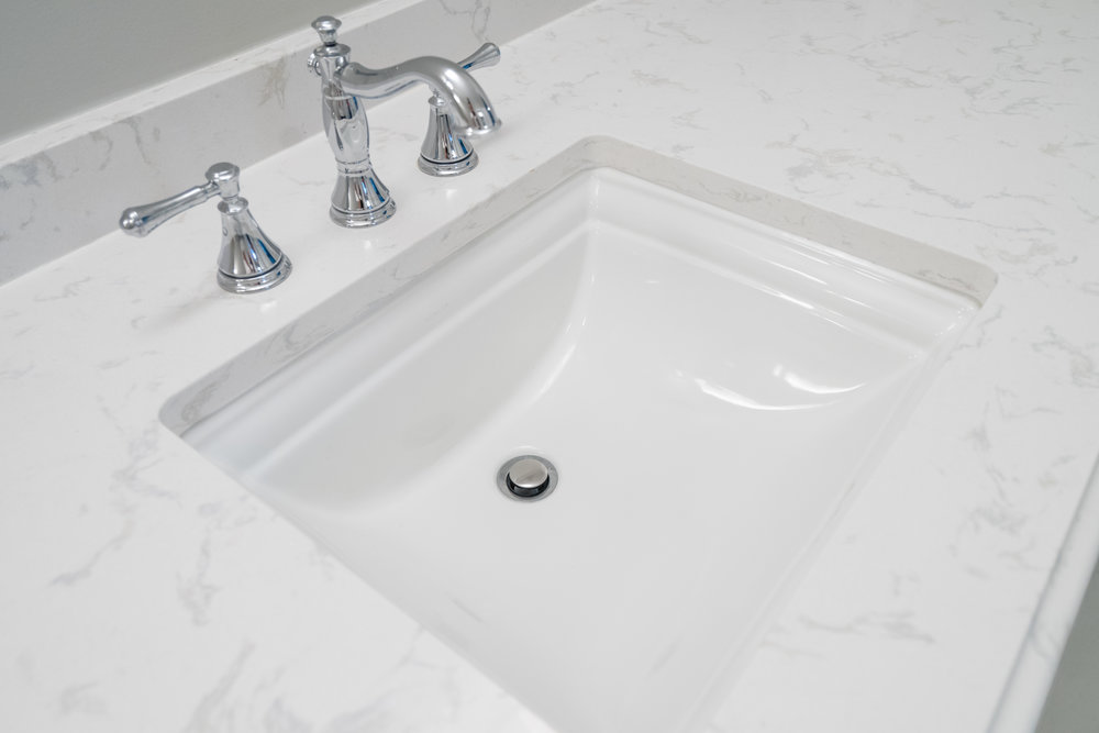 Kohler undermount sink with Polished chrome faucet and quartz countertops