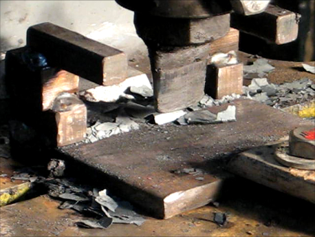 This photo shows another example of a slitting set-up with a stripper and solid bolster. Note by using the depth stop nut you can slit within a few thousandths of going through the piece without damaging your chisel.