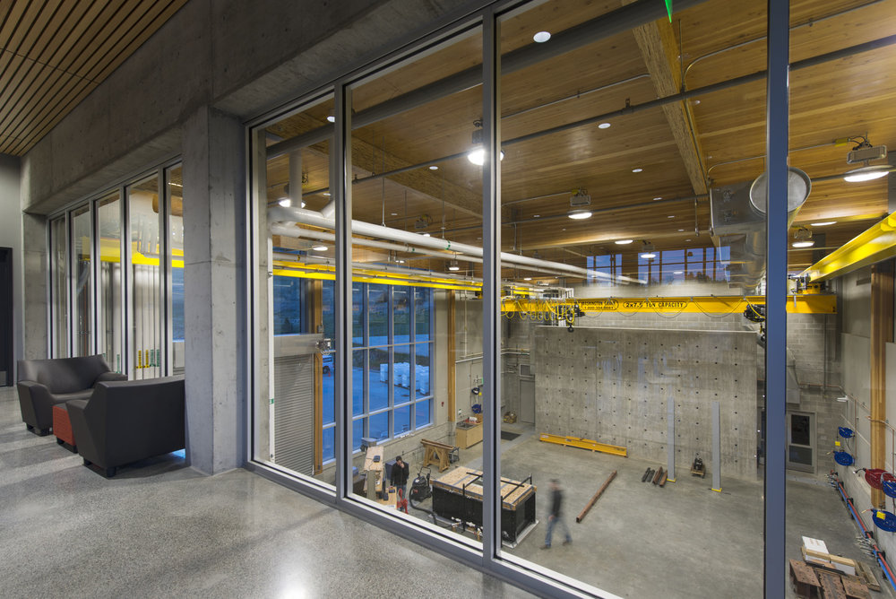 "PULLMAN, WA  / Washington State University PACCAR Environmental Technology Building  In addition to using CLT in its construction, the WSU PACCAR Building is equipped to test timber/wood products and conduct structural experiments in the impressive ""showcase bar"" and high-bay area. The space features a reaction floor and wall as well as a bridge crane.   LMN Architects, Coughlin Porter Lundeen"