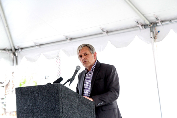 Photo by Mujale Chisbuka: Capitol Hill Housing CEO Chris Persons gives remarks during the groundbreaking.