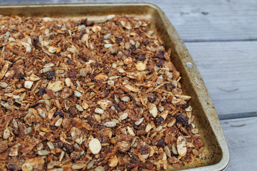Grain-Free Granola  INGREDIENTS 2 tbsp. of melted coconut oil 1 cup of sunflower seeds 1 cup of pumpkin seeds 2 cups of sliced almonds  2 tbsp. of flax seeds (ground or whole) 2 tbsp. of chia seeds 1 tbsp. of cinnamon  2 tsp. of salt  1 tbsp. of vanilla  1 cup of shredded coconut 1/4 cup of coconut flour  1/4 cup of almond butter 1/4 cup of honey  1/4-1/2 of dried cranberries  INSTRUCTIONS *Melt coconut oil on low in slow cooker  *Add all the nuts into pot, coating in coconut oil  *Add in spices, wet ingredients, and dried cranberries to the mixture  *Stir until well combined  *Cook on low for two hours. Make sure to stir every 20-30 minutes so the granola does not burn on the bottom  *Once cooked, spoon granola onto a cookie sheet, let cool, and then place in the fridge to harden  *Store in an airtight container  *Enjoy over yogurt, almond milk, or plain!