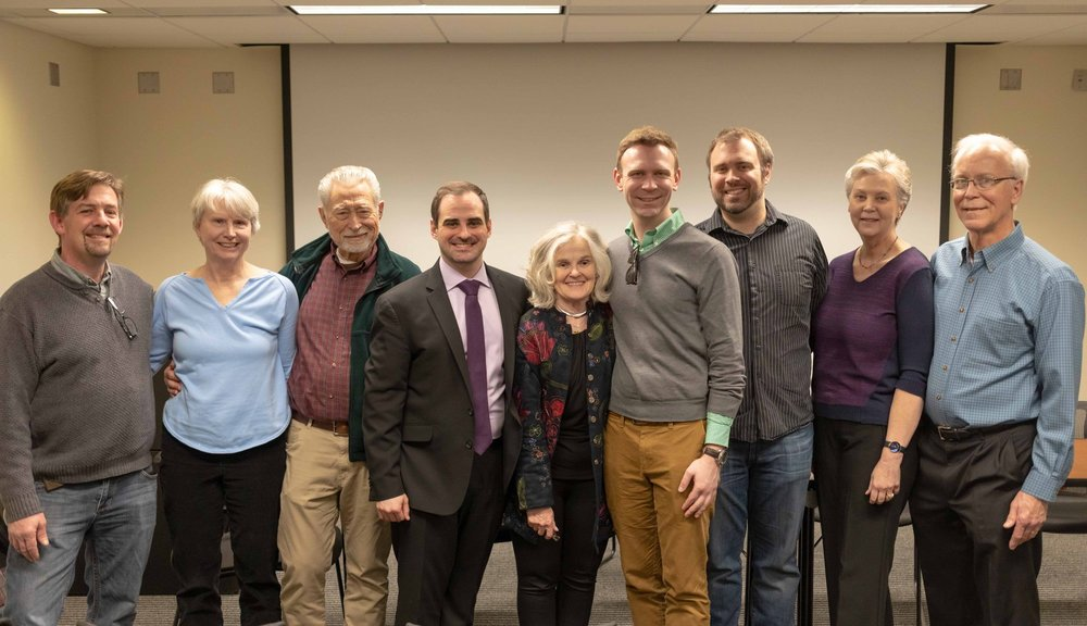 Austin and his family at doctoral defense