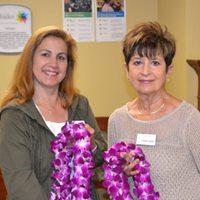 Patti Baker and Karen Swan presenting leis to Hillsides Graduates
