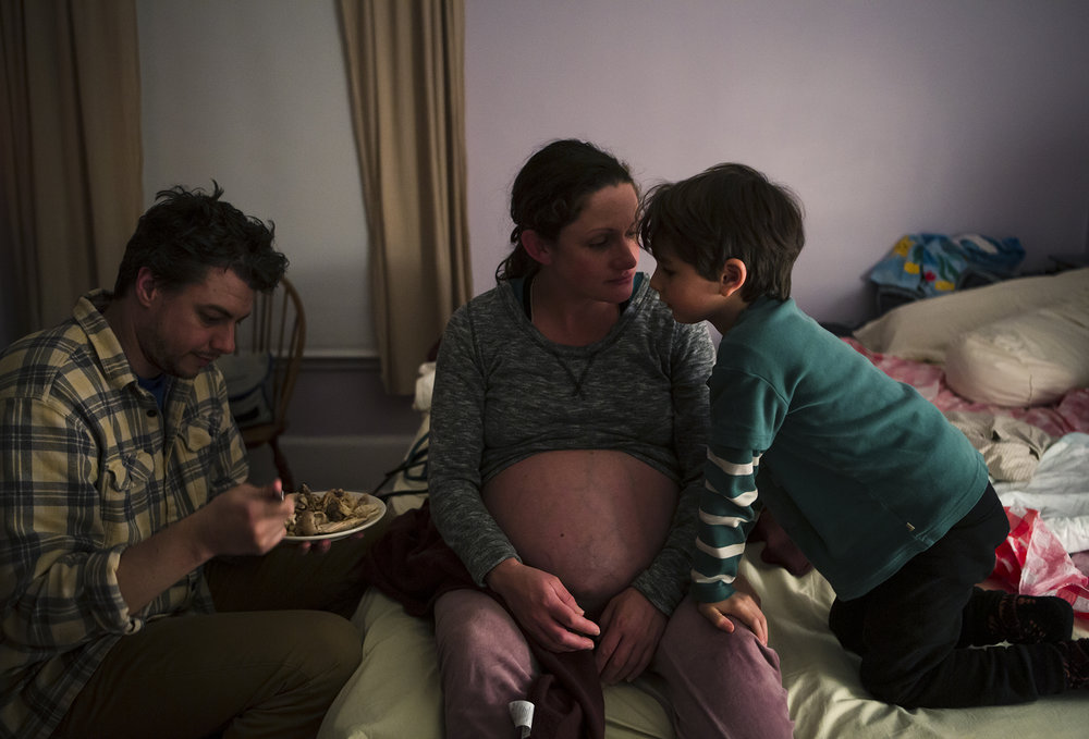a woman gives birth at home in nyc
