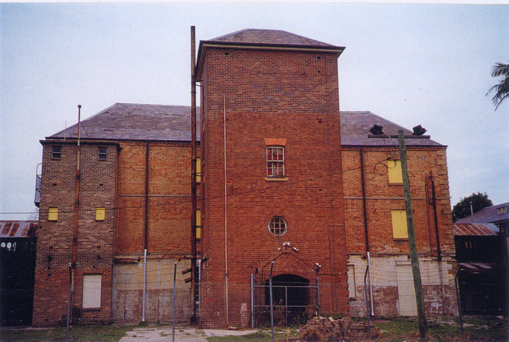 1 of 9: The northern face of the central building prior to restoration (Tanner and Associates Architects)