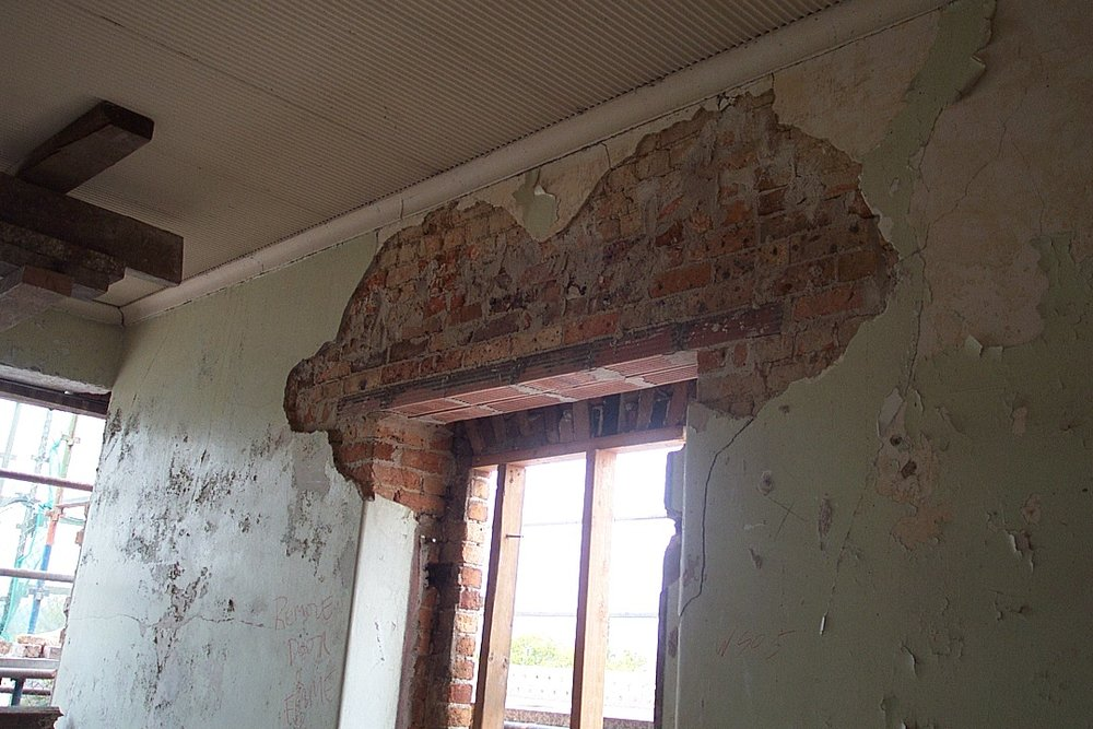 Decaying wall surfaces inside the Female Orphan School prior to its restoration (Tanner and Associates Architects)