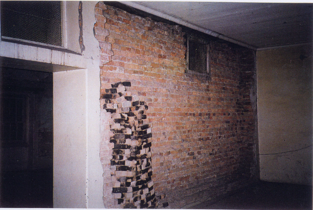 The exposed brickwork on the building's second storey, prior to restoration (Tanner and Associates Architects)
