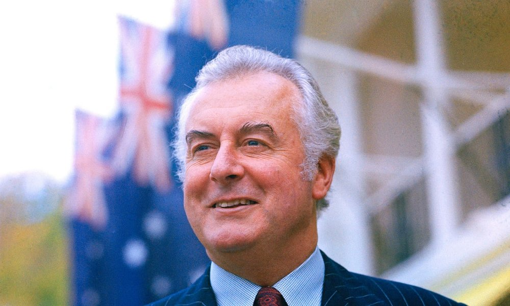 Gough-Whitlam-in-front-of-Australian-flag-colour