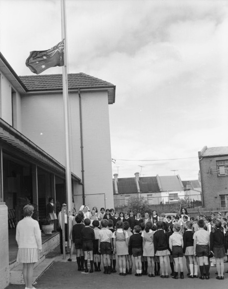 Flag raising ceremony by school children at St. Peter's School, Surry Hills, Sydney, 6 April 1971