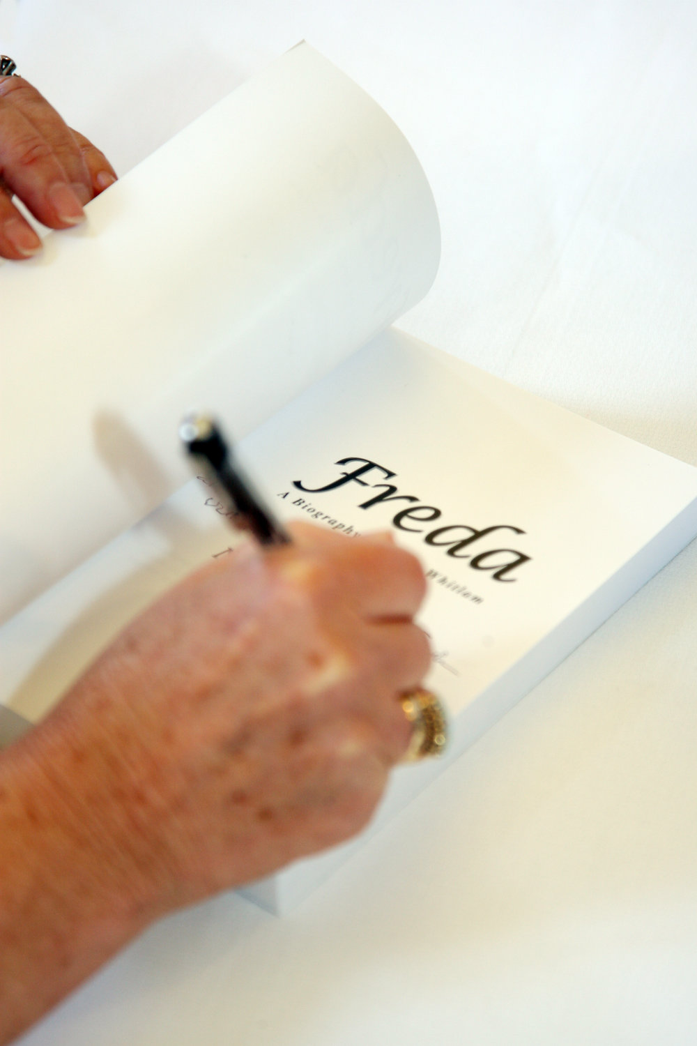 Freda Whitlam signs her biography, authored by Noelene Martin, 2009.