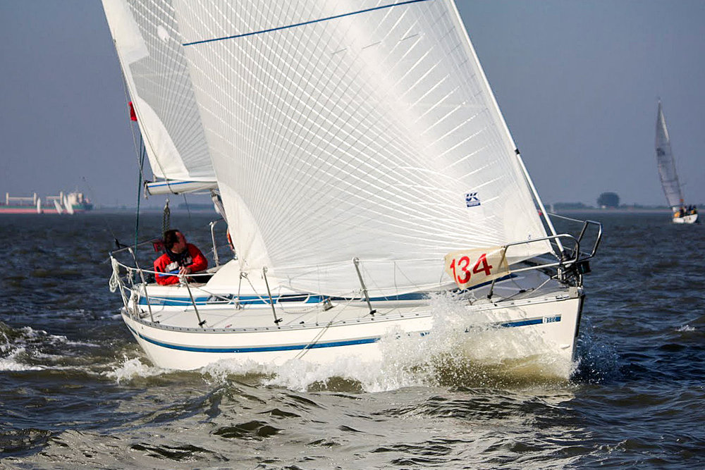Tape-Drive Silver     Description:  The less expensive polyester laminate reinforced with S-Glass fiber tapes is a great option for boats under 40-feet.     Boat size:   20-40 feet   Construction:   Cross-cut broad-seamed panels reinforced with continuous S-Glass fiber tapes bonded to the sails surface. The cross-cut panels define the sail's shape and the grid of tapes carries the primary loads of the sail to lock in sail shape.   Material:  Cross-cut panels are made of a loose weave of polyester yarns laminated in between layers of Mylar. Some polyester laminates have a single layer of polyester taffeta for abrasion resistance. The S-Glass tapes are white, which means these sails can have an all-white appearance.    Shape Stability:  ★★★     Longevity:  ★★★   Shape after   500 hours:  Circa 60%   Price:  $$