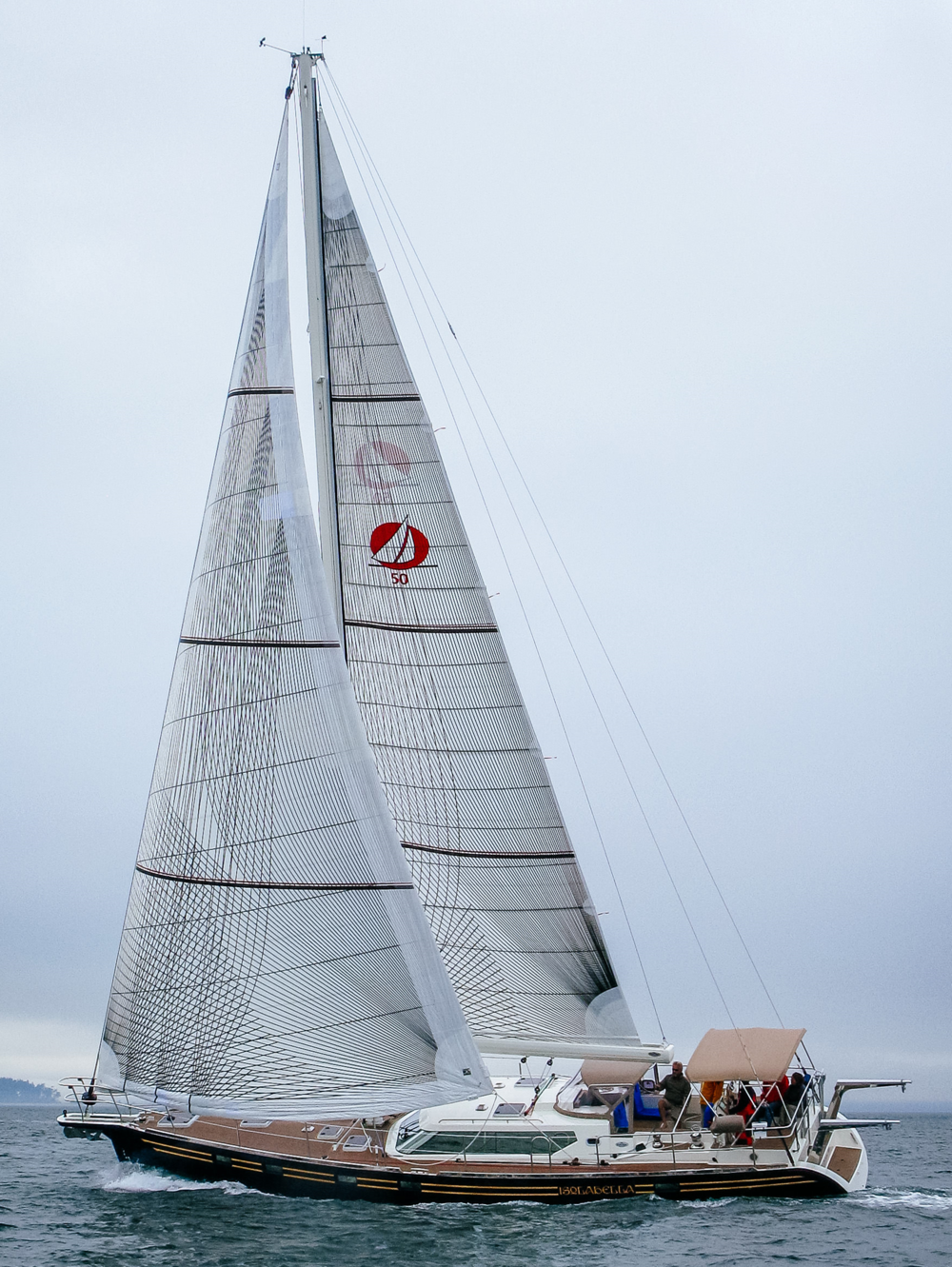 A Waterline Yachts 50 with Tape-Drive carbon Spectra performance cruising roller-reefing genoa and mainsail. Notice the 3 reef points that include sets of tapes to carry the reefed luff  loads .