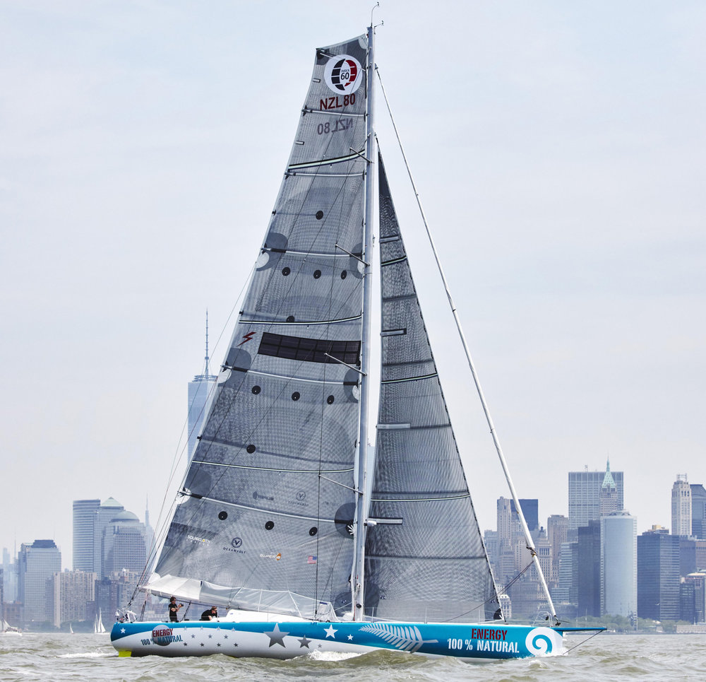 Conrad Colman's IMOCA 60 100% NATURAL ENGERGY racing in New York Harbor before setting off in the 2016-2017 Vendée Globe Race.
