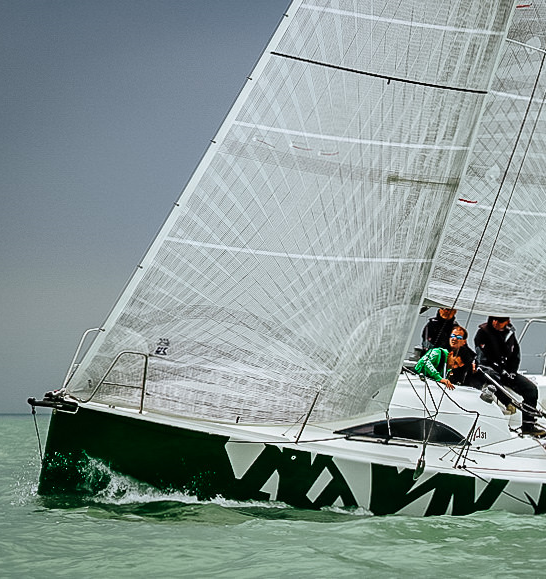 A31 VARUNA with X-Drive Carbon non-overlapping jib and main. The base material for the sail is a light polyester laminate that has a film side and a taffeta side. The tapes are bonded to the film side. Photo courtesy: www.batur.be