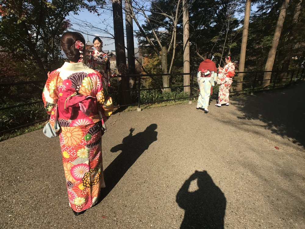Tourists wearing kimonos which you can rent.