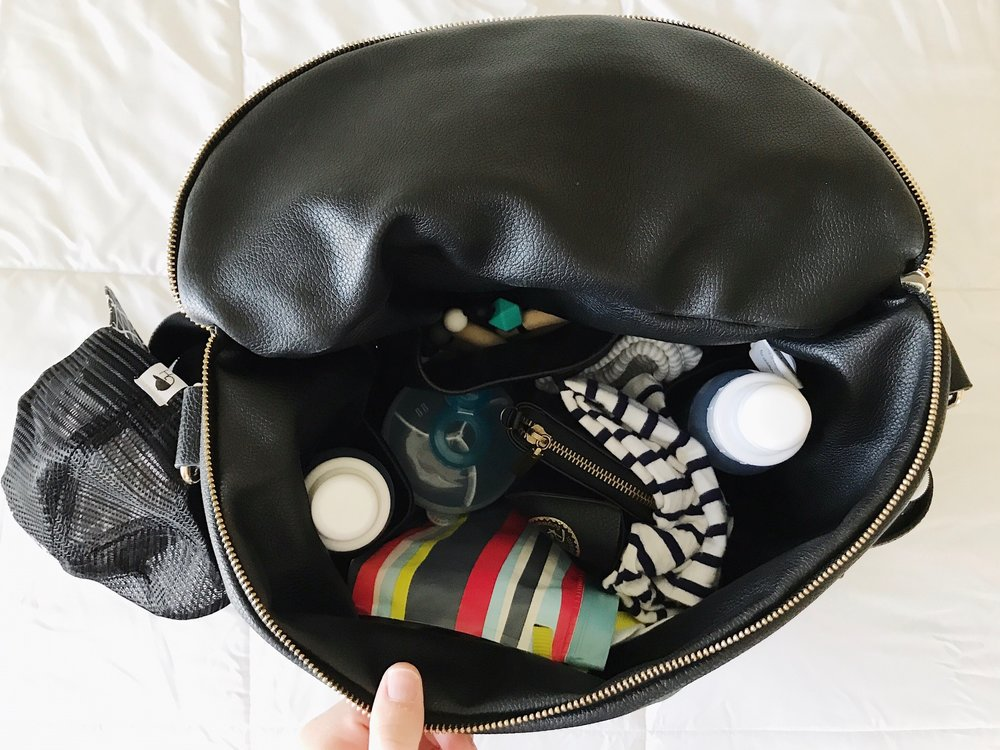 This is our daily diaper bag packed. It has 2 more inside pockets for bottles/cups and plenty of more room left to stash other things. Also has 2 outside pockets for mommas water bottle!