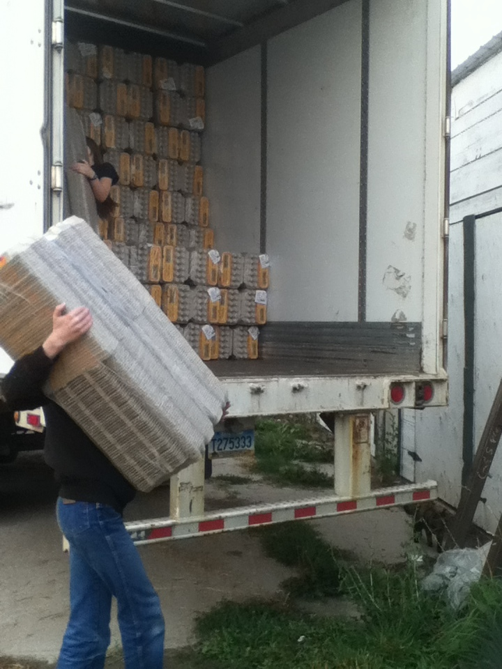 Unloading cartons is a big job, but we all pitch in to help