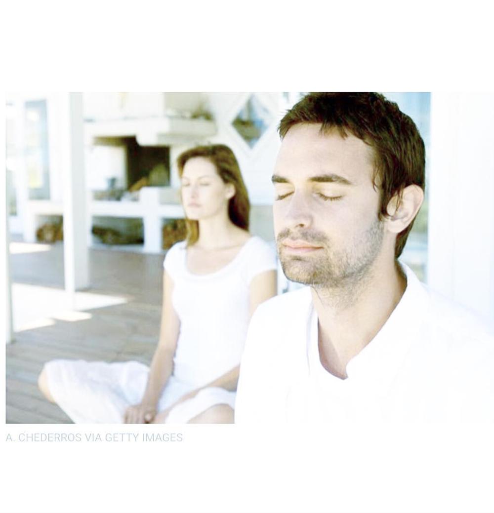 Meditating man and woman