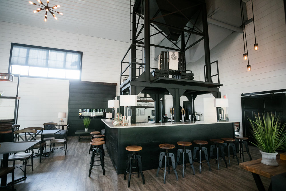 Modern Style and Subtle Drama - The moment you walk through the entrance, the 1500 sq. ft. Bin Room greets you with a modern-industrial welcome. With room to seat up to 100 guests comfortably, a fully equipped bar and modern conveniences; The Bin Room is designed to exceed the expectations of your small to medium size parties and gatherings. This flexible space can be rearranged to meet any gathering need and is the perfect place for your Wedding Day cocktail hour!