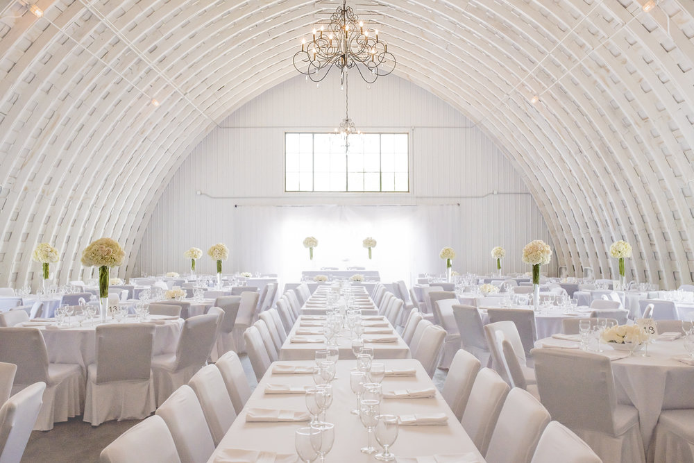 "Vintage Elegance - The dramatic entrance through the full-glass doors and white sheers opens to the beauty and grace of a 100 year old Quonset.  Modern elegance and vintage charm combine to create a truly unique chemistry that many describe as ""breathtaking"". Created with ceremony and reception in mind, The Quonset invites parties from 100 to 285 guests."