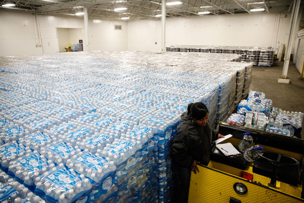 Pallets of bottled water serve as the emergency water supply for Flint residents affected by lead-contaminated water. (Photo by Sarah Rice/Getty Images)