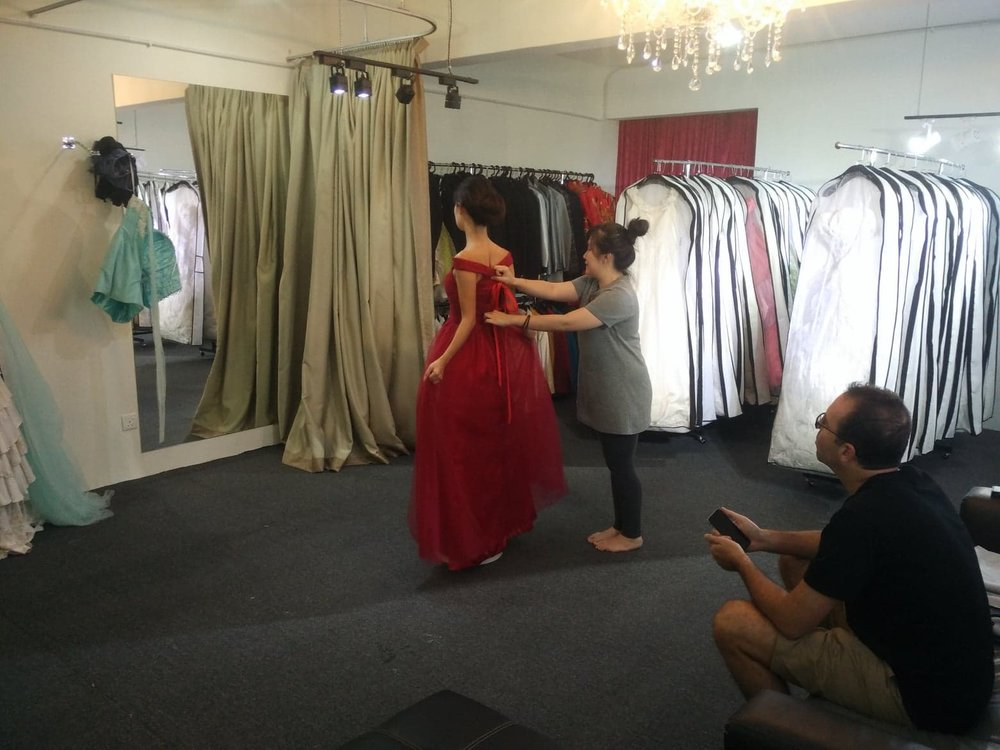 Trying out the designs & fittings for Jiebei's gown, while Sylvain watches on. Gowns courtesy of Impegno Wedding.