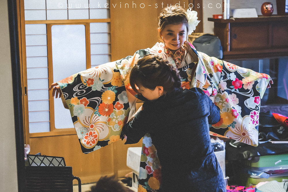 You will need to hire a professional Japanese make-up artist to help you put on the Kimono, it's a really complicated process with many different layers.