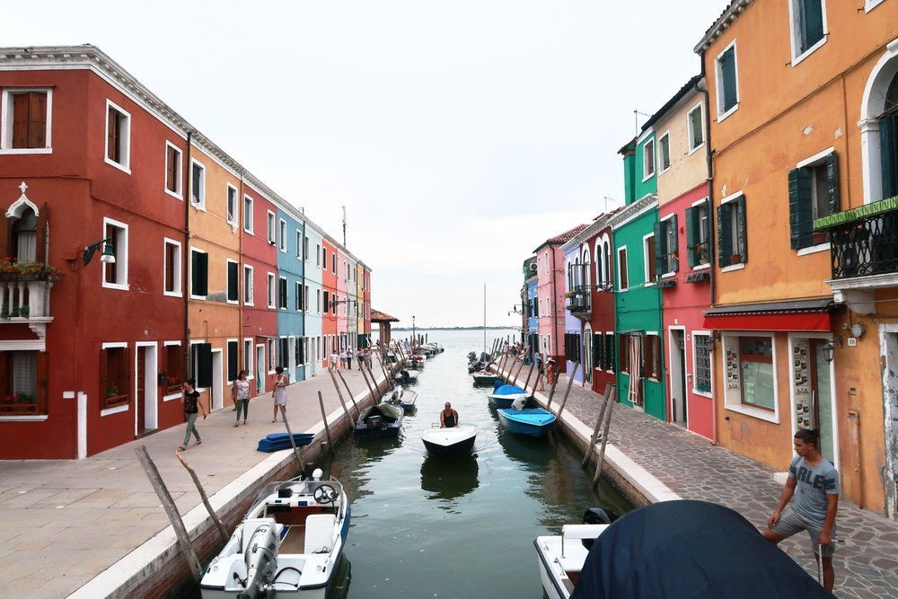 Take an hour's water bus ride to get to Burano where you'll stroll along canals lined with brightly-coloured buildings. Great for Instagram!