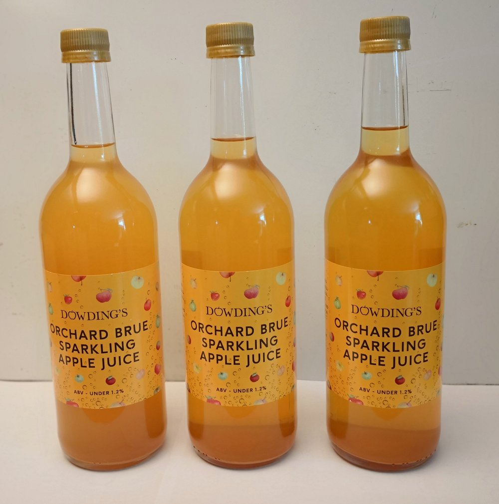 The Orchard Brue is perhaps less sparkiing but does have a little alcohol. It is also much sweeter than the traditional juice. We only made a small amount and thus it's not in the online shop. I am selling most at markets or direct, at £3.50/bottle or £40/case of 12.