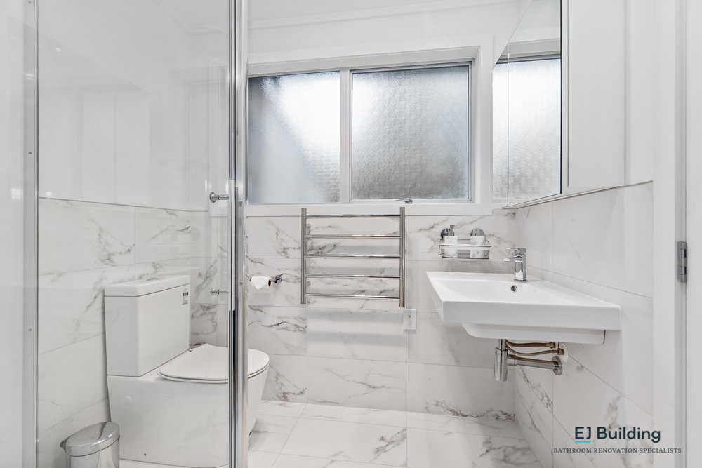 Bathroom tiles, half high, open basin, clean looking bathroom. click for more before and after ideas.